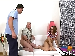 Young girl gives a blow to old ramrod