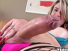 Busty tranny Nanda Molinari masturbating on the bed - Shemaleidol