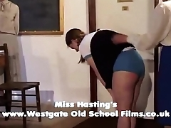 Penny spanked and caned in front of class
