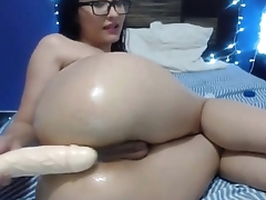 beautiful brunette with huge dildo fucks her oiled ass